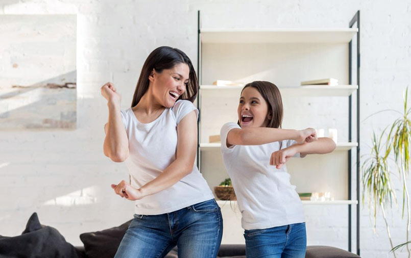 Dancing mother and daughter